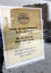 The sign on Brick & Bourbon's door indicates it will open its St. Cloud location soon.