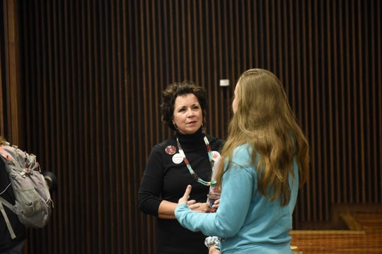 St. Cloud State University grad and state Rep. Mary Kunesh-Podein, D-New Brighton, chats with people after presenting on campus Wednesday, Nov. 13, 2019, about a new task force on missing and murdered idigenous women.