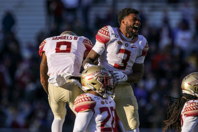 Nov 9, 2019; Chestnut Hill, MA, USA; Florida State Seminoles running back Cam Akers (3) and Florida State Seminoles cornerback Stanford Samuels III (8) celebrate after an interception during the second half against the Boston College Eagles at Alumni Stadium. Mandatory Credit: Paul Rutherford-USA TODAY Sports