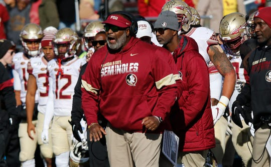 Florida State interim head coach Odell Haggins shouts instructions from the side in the first half of an NCAA college football game against Boston College, Saturday, Nov. 9, 2019, in Boston. (AP Photo/Bill Sikes)