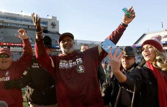 Florida State interim head coach Odell Haggins acknowledges fans in the stands after his team defeated Boston College in an NCAA college football game, Sunday, Nov. 10, 2019, in Boston. (AP Photo/Bill Sikes)
