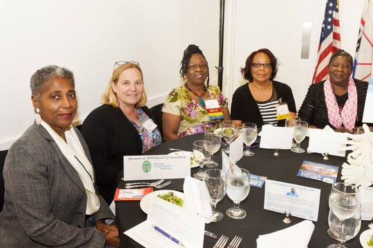 Arlease Hall, left, Ann Hubbard, Mary Sirmons, Betty Barnes and Betty Bradwell at the Hand Up Luncheon for United Against Poverty St. Lucie at Riverwalk in Fort Pierce on Oct. 24, 2019.