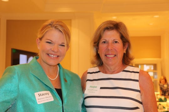 Stacey Watson-Mesley, left, chief executive officer of Big Brothers Big Sisters of St. Lucie, Indian River and Okeechobee Counties, with Hope Woodhouse, president of the  John's Island Community Service League.