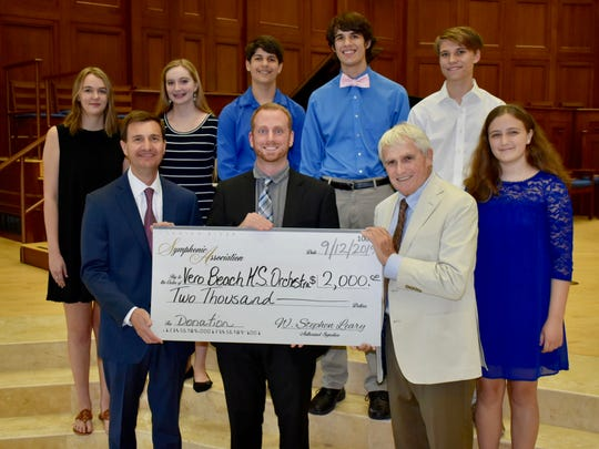 The Indian River Symphonic Association recently presented the Vero Beach High School Orchestra with $2,000. Pictured are, from left, front row, association Treasurer Dave Johnson, VBHS Orchestra Director Mark Shuping, association Vice President Ed Shanaphy, with Marie Lorenz, back row, Shelby O'Connor, Thomas Miller, Andrew Miller, John Amos and Grace Murphy.