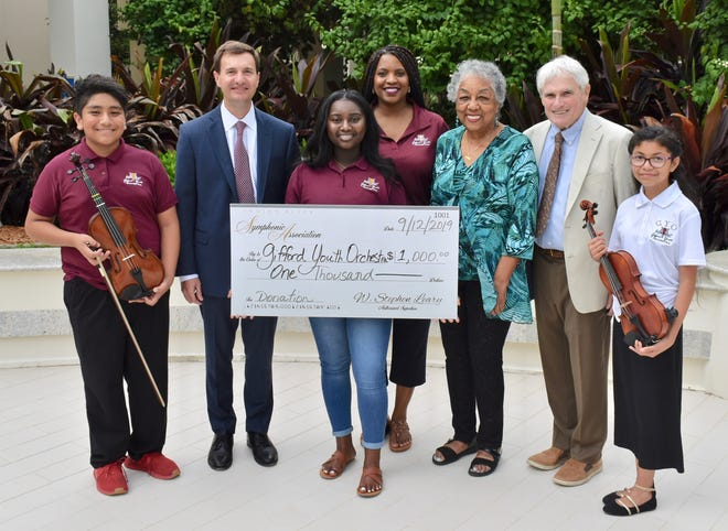 The Indian River Symphonic Association recently presented the Gifford Youth Orchestra with $1,000. Pictured are, from left, Jhovanny Vite, association Treasurer Dave Johnson, Jada Powell, orchestra Executive Director of Programs Iva Powell, orchestra Co-Founder and Artistic Director Dr. Crystal Bujol, association Vice President Ed Shanaphy and Isabella Cruz.