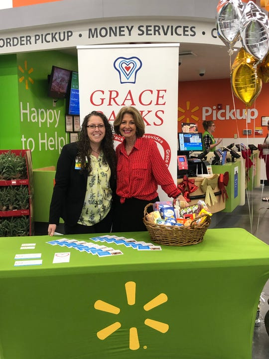 Walmart store manager Heather Gunnell (right) and Grace Packs founder Laura Klosterman won $10,000 for the local nonprofit, which provides weekend meals to food insecure children in St. Lucie County.