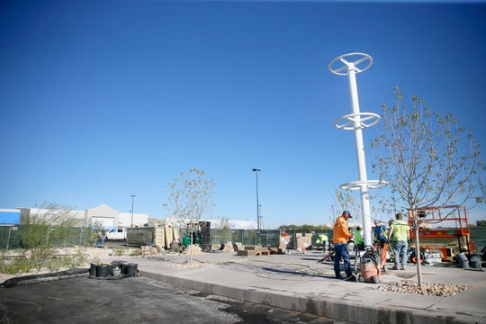 "Construction continues on ""The Grand Candela,"" a permanent memorial at the Walmart in the Cielo Vista area, on Wednesday, Nov. 13, 2019, in El Paso. The memorial is in remembrance of the 22 people killed and 25 others wounded when a gunman opened fire at Walmart on Aug. 3."