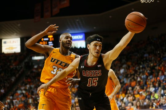 UTEP's Efe Odigie goes against New Mexico State University's Ivan Aurrecoechea during the game Tuesday, Nov. 12, at the Don Haskins Center in El Paso.