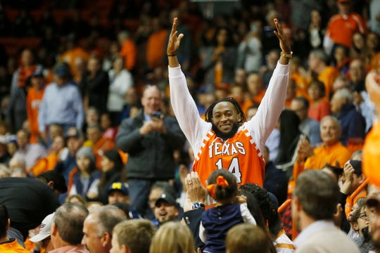 Aaron Jones cheers towards the student section at the UTEP vs. New Mexico State University Tuesday, Nov. 12, at the Don Haskins Center in El Paso.
