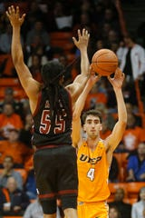 UTEP's Eric Vila goes against New Mexico State University defense during the game Tuesday, Nov. 12, at the Don Haskins Center in El Paso.