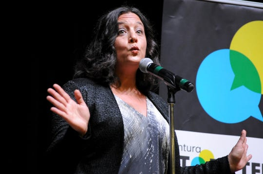 """Erica Blumfield, 43, shares a personal story during the Ventura Storytellers Project show at the Oxnard Performing Arts & Convention Center on Tuesday. The theme of the night was """"Blended,"""" which storytellers were encouraged to interpret in a number of ways."""