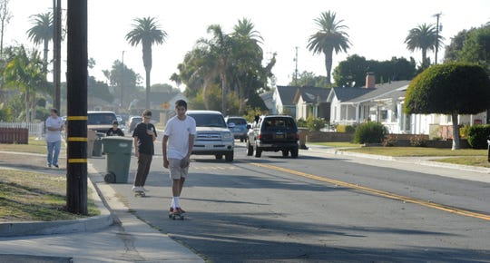 Boys ride skateboards and walk along Bristol Road near Katherine Avenue in the Montalvo neighborhood of Ventura. The formerly unincorporated area will soon have bike paths, sidewalks and other pedestrian-friendly features.