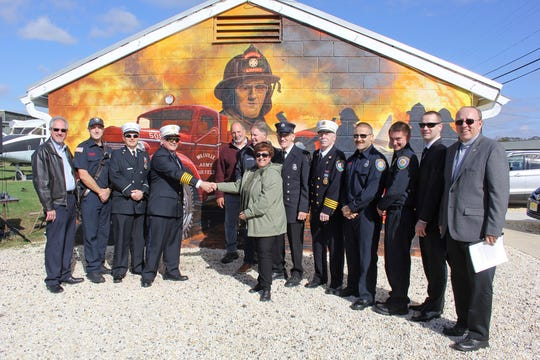 The Millville Army Air Field Museum unveiled a new mural on Nov. 2 at its 18th annual Veterans Appreciation Day at Millville Executive Airport. The mural, located in the airport's historic district, honors the Millville Air Field Fire Department that was active during World War II at America's First Defense Airport.