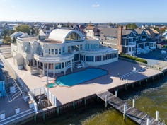 Actor Joe Pesci's gated, waterfront property is in the  West Point Island neighborhood of Lavallette, New Jersey. It's on Barnegat Bay.