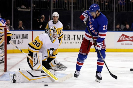 Nov 12, 2019; New York, NY, USA; Pittsburgh Penguins goaltender Matt Murray (30) makes a save in front of New York Rangers center Brett Howden (21) during the second period at Madison Square Garden.