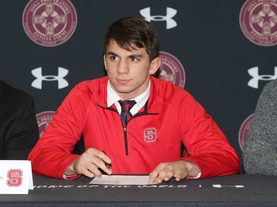 Iona Prep's AJ Kovacs signs to wrestle at North Carolina State University during signing day at Iona Prep High School in New Rochelle on Wednesday, November 13, 2019.