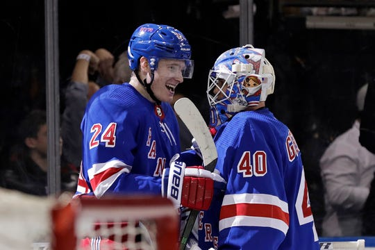 Nov 12, 2019; New York, NY, USA; New York Rangers right wing Kaapo Kakko (24) is congratulated by goaltender Alexandar Georgiev (40) after scoring the game winning goal against the Pittsburgh Penguins during overtime at Madison Square Garden.