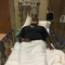 Erwin L. Church recovers in a hospital following a 2018 incident in which he said he was punched by Frank E. Acierno Jr.