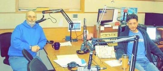 Carl Hilke with James Malouf in the radio station studio