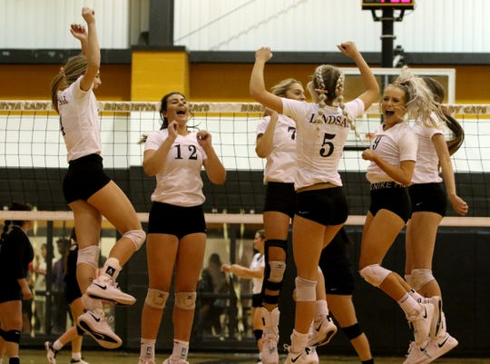 Lindsay celebrates winning a point against Archer City Tuesday, Nov. 12, 2019, in Henrietta. The Lady Knights defeated the Lady Cats 3-0 (28-26, 25-19, 25-19).