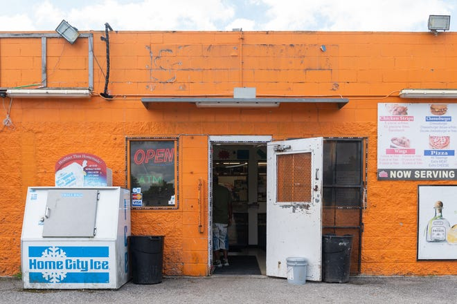 """Chalie's Convenient Market in Washington Park, Illinois, is known as the """"Orange Store"""" among neighbors. The corner store just outside St. Louis is an authorized SNAP retailer."""