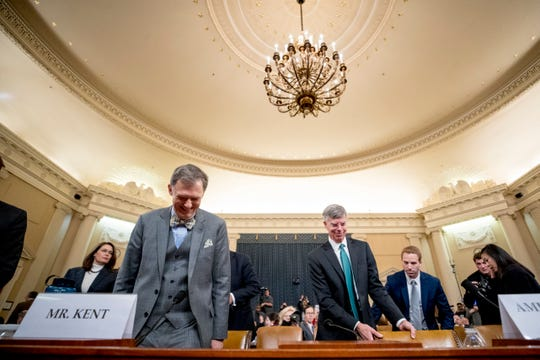 Career Foreign Service officer George Kent, left, and top U.S. diplomat in Ukraine William Taylor, right, return from a short break in testimony before the House Intelligence Committee on Capitol Hill in Washington, Wednesday, Nov. 13, 2019, during the first public impeachment hearing of President Donald Trump.