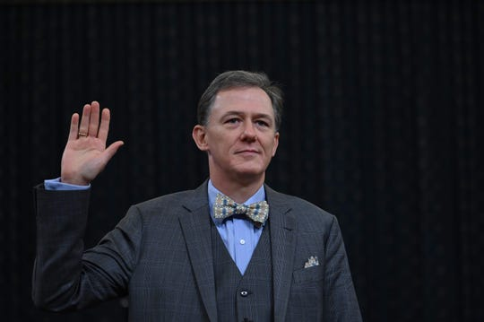 George Kent, the deputy assistant secretary of state for European and Eurasian Affairs  takes the oath during the impeachment inquiry into US President Donald Trump in Washington, DC on November 13, 2019. - Donald Trump faces the most perilous challenge of his three-year presidency as public hearings convened as part of the impeachment probe against him open under the glare of television cameras on Wednesday. (Photo by Andrew CABALLERO-REYNOLDS / AFP) (Photo by ANDREW CABALLERO-REYNOLDS/AFP via Getty Images) ORIG FILE ID: AFP_1M87AY