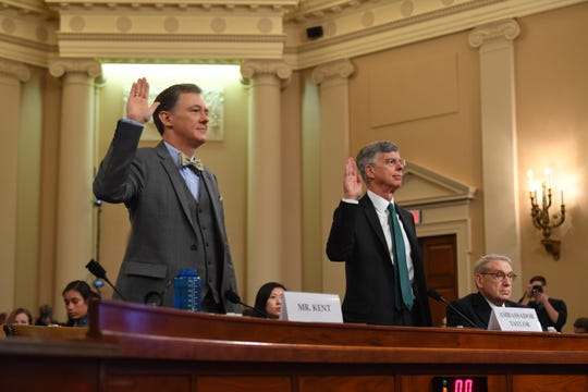State Department Ukraine-Russia expert George Kent, left, and William B. Taylor, Jr., the top American diplomat in Ukraine are sworn in ahead of testifying before the Permanent Select Committee on Intelligence as the first witnesses in public congressional hearings in the impeachment inquiry into allegations President Donald Trump pressured Ukraine to investigate his political rivals on Nov. 13, 2019.