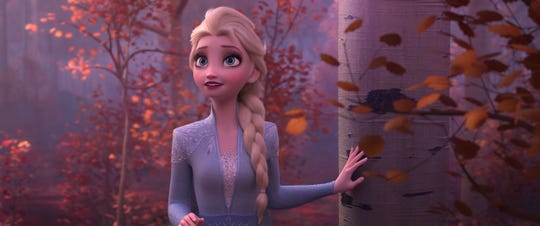 "Elsa (voiced by Idina Menzel) finds herself called to a mysterious enchanted forest in ""Frozen 2."""