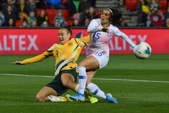 Australia's forward Caitlin Foord, left, vies for the ball with Chile's defender Su Helen Galaz during an international friendly football match between Australia and Chile at Coopers Stadium in Adelaide, Australia.
