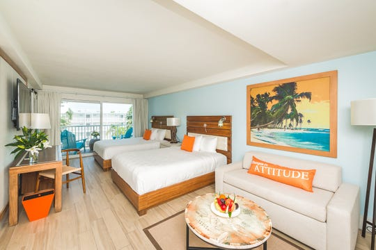 All 285 rooms at Margaritaville Beach Resort Grand Cayman ooze a Caribbean vibe and spacious balconies outfitted with Jimmy Buffett's classic blue Adirondack chairs.