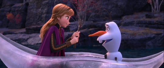 """Anna (voiced by Kristen Bell, left) and Olaf (Josh Gad) deal with life changes in """"Frozen 2."""""""