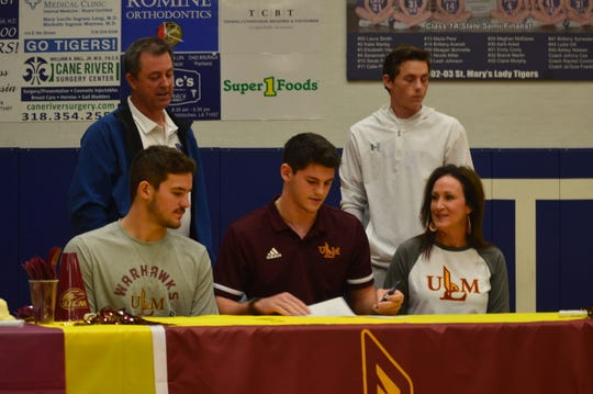 St. Mary's boys basketball player Thomas Howell (center) signed with ULM Wednesday.