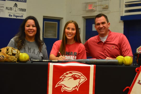 St. Mary's softball player Ragan Hale (center) signed with Lamar Wednesday.