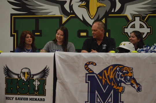 Menard softball's Olivia Johnson (second left) signs her National Letter of Intent to Memphis Wednesday.