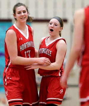 Hortonville's Macy McGlone, left, celebrates with Morgan Draheim during a game last season in Appleton. McGlone signed with UW-Milwaukee on Wednesday and Draheim signed with St. Cloud State.