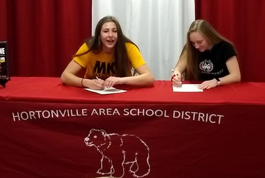 Hortonville's Macy McGlone, left, signed to play college basketball at UW-Milwaukee while teammate Morgan Draheim signed to play at St. Cloud State.