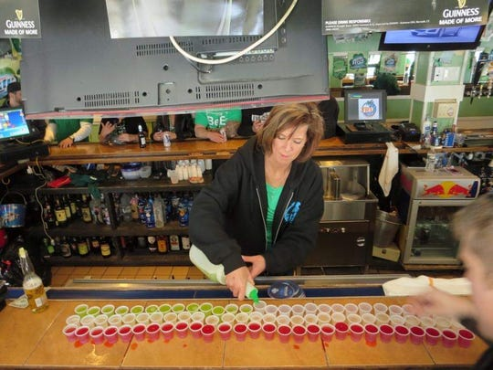 Liz Brown pouring drinks at The Sawmill in Seaside Park.