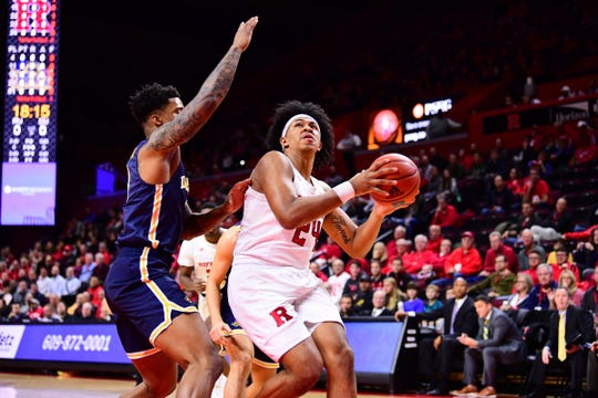 Ron Harper Jr. drives for Rutgers against Drexel