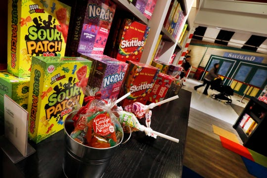 In this Tuesday, Nov. 5, 2019, photo candy is displayed in the Tasty Treats section at the Macy's flagship store, in New York. With three weeks until the official start of the holiday shopping season, the nation's retailers are gearing up for what will be another competitive shopping period. (AP Photo/Richard Drew)