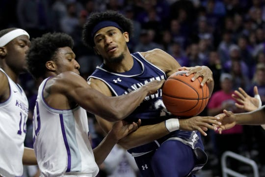 Monmouth guard Marcus McClary, right, drives on Kansas State forward Xavier Sneed during the first half of an NCAA college basketball game in Manhattan, Kan., Wednesday, Nov. 13, 2019.