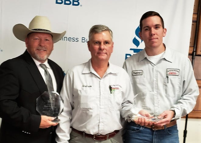 The Abilene Better Business Bureau presented it's 2019 Torch Award on Thursday to Darrin Black, left, owner of Black Plumbing, and Bug Blasters' Andrew Turnbull, center, vice president, and Tanner Jones, president.