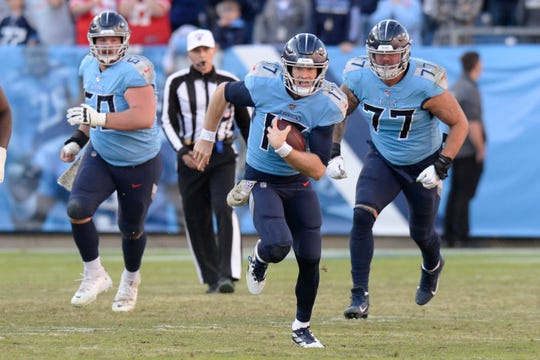Tennessee Titans quarterback Ryan Tannehill (17) scrambles against the Kansas City Chiefs in the second half Sunday, Nov. 10, 2019, in Nashville, Tenn. The Titans won 35-32.
