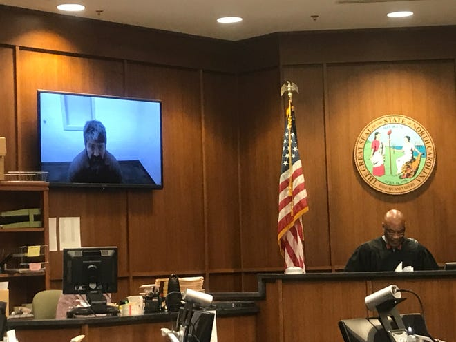 Keith William Grandy attends his bond hearing via video call from Buncombe County Detention Facility with Chief District Judge J. Calvin Hill presiding.
