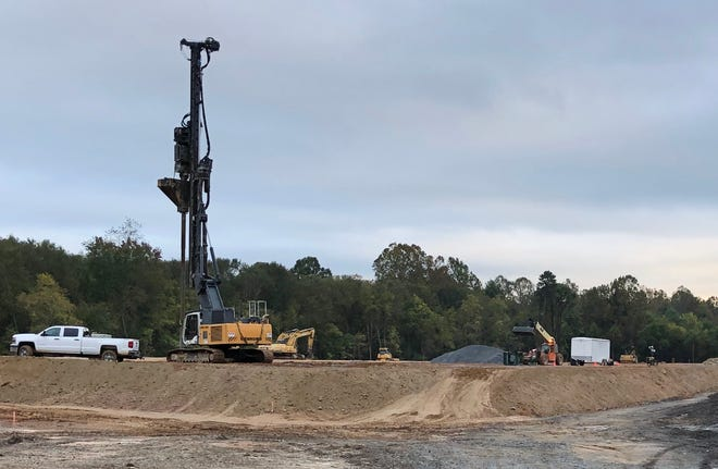 A pile driver was on site recently at a Fletcher construction site where a 300,000-square-foot building is under construction. Sources say the hanger manufacturer Mainetti will locate there.