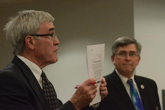 Defense attorney J. Thomas Schaeffer argues a point while Prosecutor David Gilbert listens.