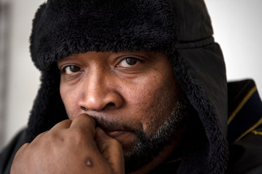 Tyrone Johnson, 45,poses for a portrait, reflecting on his search for affordable housing on Thursday, Nov. 14, 2019 at Haven of Rest Ministries in Battle Creek, Mich. Johnson is currently employed and is struggling to find housing because of the felony charge on his record.