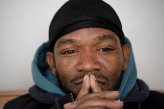 Shawn Jackson, 43, poses for a portrait, reflecting on his search for affordable housing on Thursday, Nov. 14, 2019 at Haven of Rest Ministries in Battle Creek, Mich. Jackson is currently employed and is struggling to find housing because of the felony charge on his record.
