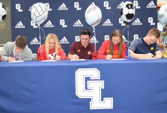Gull Lake hosted a signing ceremony with Blue Devil athletes, from left,  Nolan Jaros, Lexie Beeke, Luke Scoles, Rosie Wisser and Dylan Stanton all signing with their respective colleges.