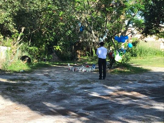 Quamel Wynn stands near the memorial set up for homicide victim Jerome Harris.